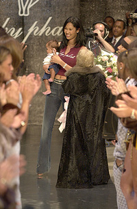 Kimora Lee Simmons on the runway holding her baby at the Kimora Lee Simmons Baby Phat Lingerie Runway Show during the Urbanworld Film Festival Launch Party in New York City - August 03, 2000  (Photo: Dimitris Kambouris-Fashion Wire Daily)