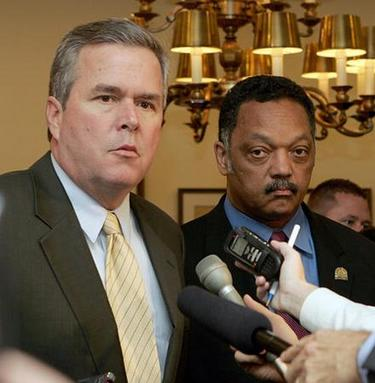 The Rev. Jesse Jackson, right, and Florida Gov. Jeb Bush speak to the media about the Terri Schiavo case on Wednesday, March 30, 2005, in Tallahassee, Fla. A federal appeals court agreed to consider an emergency bid by Schiavo's parents for a new hearing on whether to reconnect her feeding tube, raising their fading hopes of keeping the severely brain-damaged woman alive.(AP Photo/Steve Cannon)
