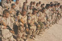 Iraqi Civil Defense Corps Commandos wait for instructions before practicing room-clearing techniques during training at Camp Ramadi, withing 1st Marind Division's zone. Army drill sergeants with 1st Brigade Combat Team, 1st Infantry Division, a unit assigned to the 1st Maring Division, taught the 24-day Commando Course. The Commandos will begin real-world operations in the coming weeks. PHOTO: Cpl. Paula M. Fitzgerald